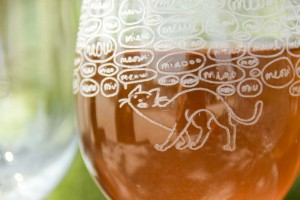 laser engraved details of cats on wine glas