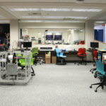 Wideshot of SU MakerSpace, showing 3D printers